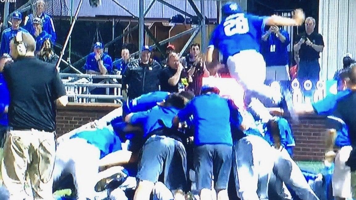 Closer Logan Salow takes flight as Kentucky's baseball team celebrates its regional championship. (ESPN screen shot)