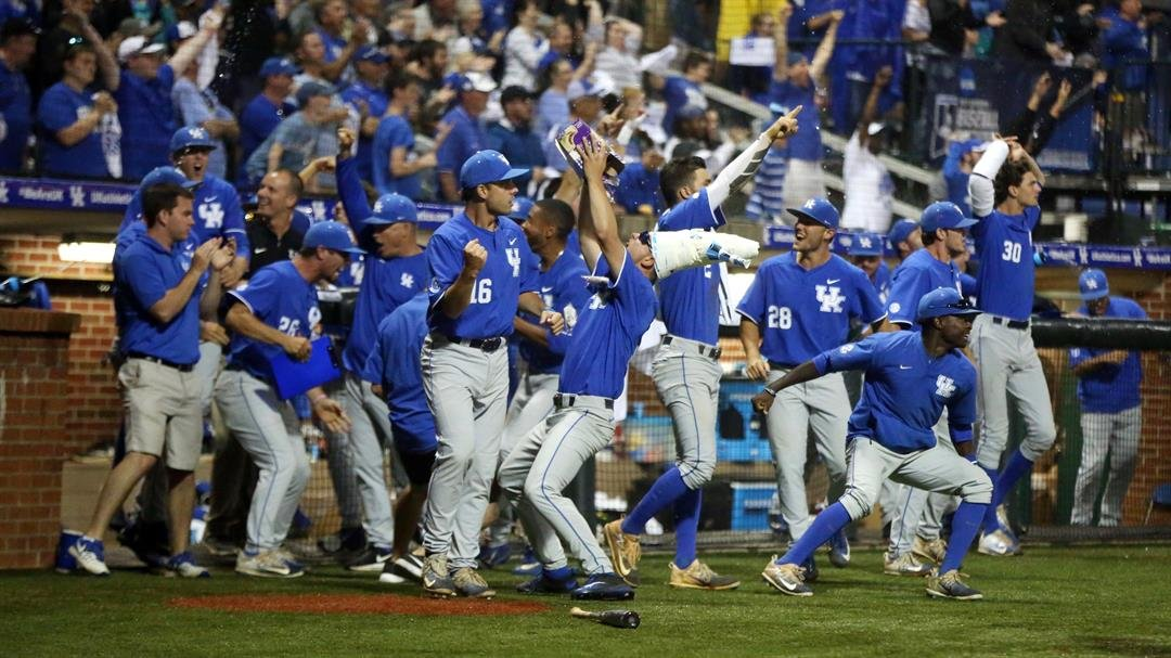 Kentucky baseball players celebrate outside their dugout after winning an NCAA regional title. (UK Athletics photo)