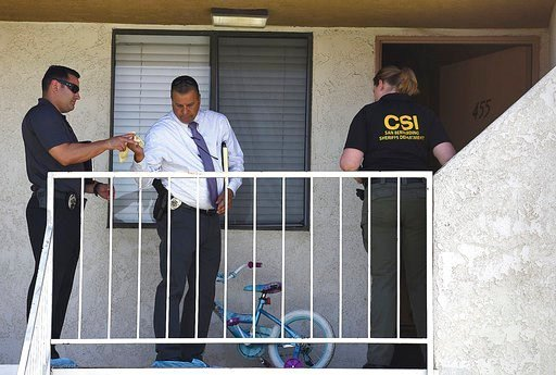 (Rick Sforza/Los Angeles Daily News/SCNG via AP). Colton, Calif., police investigate the scene where a 6-month-old baby was killed and her sister and mother were hospitalized in critical condition after a stabbing attack at their apartment.
