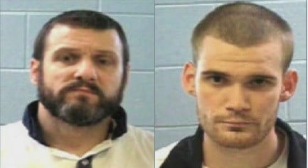 Authorities seek 2 escaped inmates after 2 guards killed