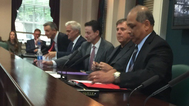Then U of L-acting president Neville Pinto, Rick Pitino, Tom Jurich and university attorneys discuss the NCAA charges. (WDRB photo by Eric Crawford)