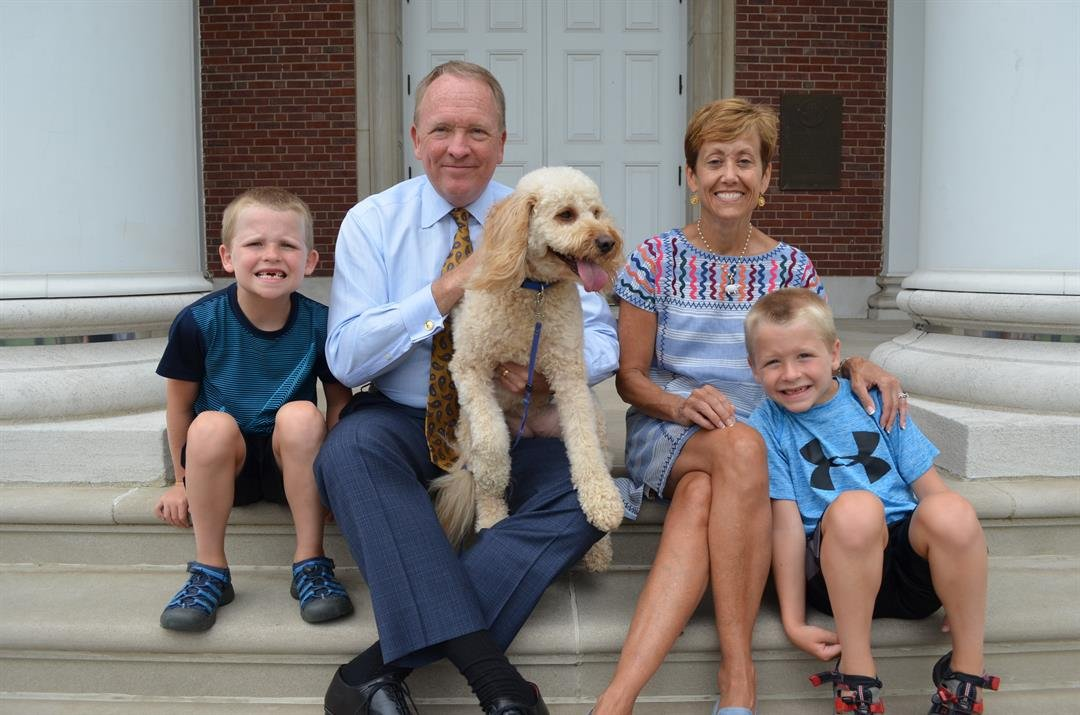 Postel with his wife, Sally, and twin sons Chris (left) and Alex, age 6, and their dog Tesla. (Photo courtesy of U of L)