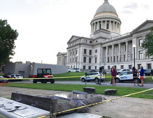 (AP Photo/Jill Zeman Bleed). The new Ten Commandments monument outside the state Capitol in Little Rock, Ark., is blocked off Wednesday morning, June 28, 2017, after someone crashed into it with a vehicle.