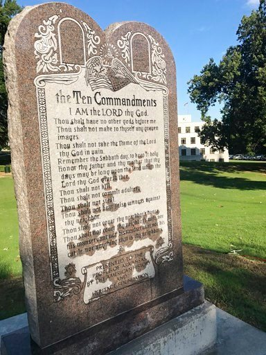 (AP Photo/Jill Zeman Bleed). A 6-foot-tall privately funded Ten Commandments monument is seen on the Arkansas Capitol grounds in Little Rock on Tuesday, June 27, 2017, after it was installed by workers .