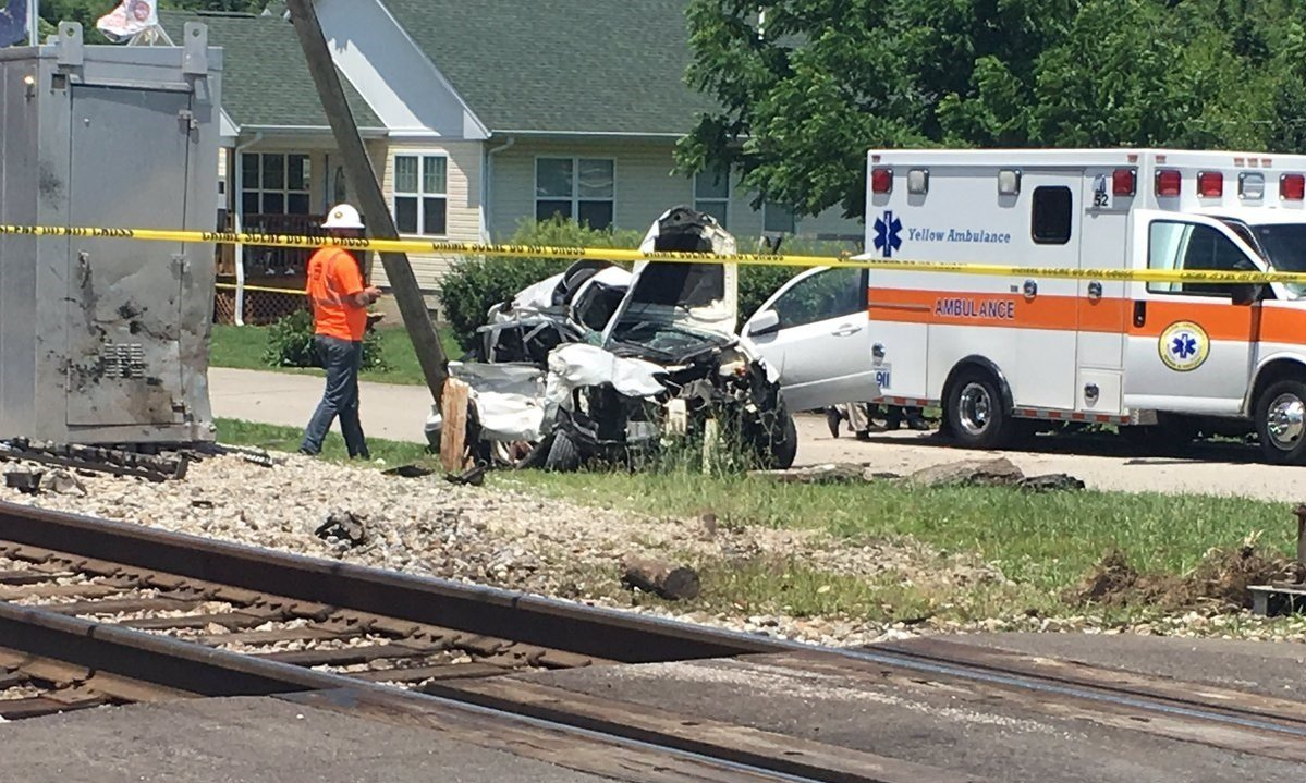 Crews assess damage after a train collided with an SUV around 1:30 p.m. June 28 near State Road 160 and Pennsylvania Street in Henryville on June 28, 2017.