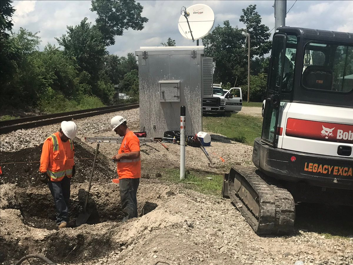 CSX crews replace a damaged communication box on June 29, 2017, one day after a fatal crash involving a train and an SUV.
