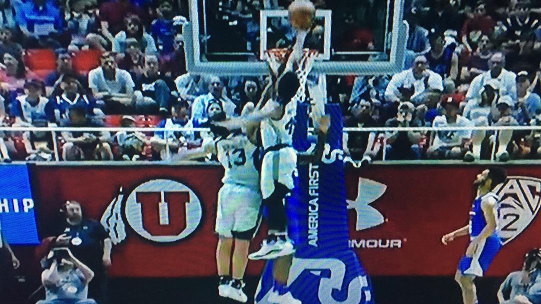 Utah's Donovan Mitchell follows his own shot with a put-back in NBA Summer League play. (NBA screen shot)