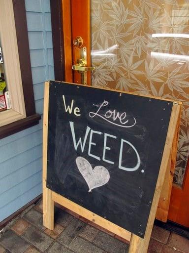 (AP Photo/Becky Bohrer). A sign stands outside Rainforest Farms, a retail marijuana shop in downtown Juneau, Alaska, on Tuesday, July 11, 2017.