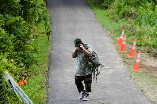 (AP Photo/Matt Rourke). A man speaks on his phone at the entrance to a blocked off driveway, Wednesday, July 12, 2017, in Solebury, Pa.