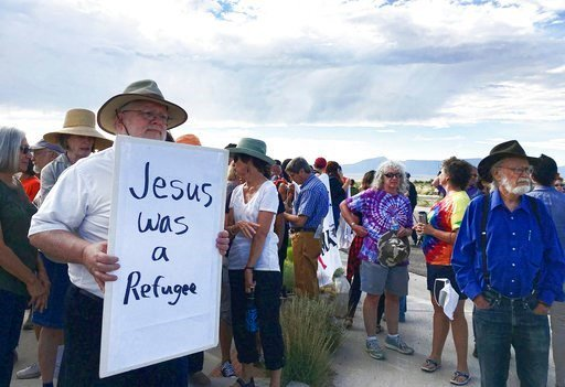 (AP Photo/Russell Contreras). Demonstrators rally in support of Iraqi refugee Kadhim Al-bumohammed outside of Immigration and Customs Enforcement offices in Albuquerque on Thursday, July 13, 2017.