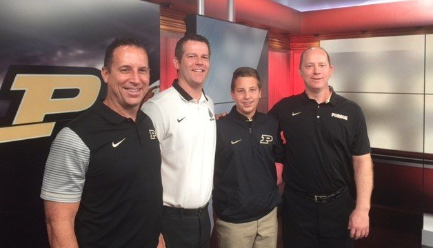 Jeff Brohm (right) has his brothers Greg and Brian and son Brady on board as he takes charge of the Purdue football program.