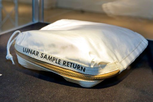 (AP Photo/Richard Drew). The Apollo 11 Contingency Lunar Sample Return Bag used by astronaut Neil Armstrong, sold for $1.8 at Sotheby's auction.