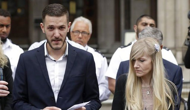 (AP Photo/Matt Dunham). Chris Gard, the father of critically ill baby Charlie Gard finishes reading out a statement next to mother Connie Yates, right, at the end of their case at the High Court in London, Monday, July 24, 2017.