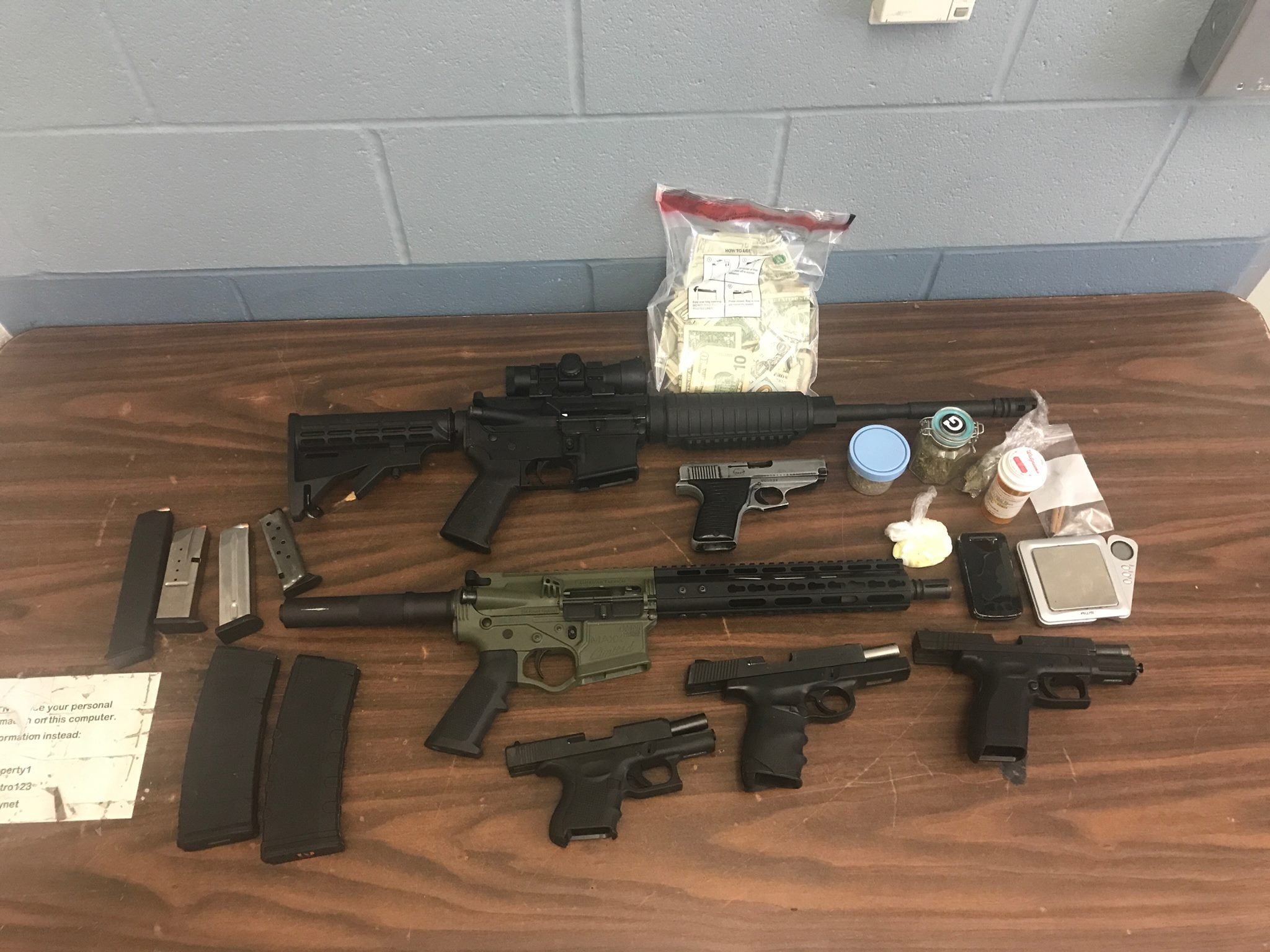 Guns, drugs, and cash seized by LMPD Friday.