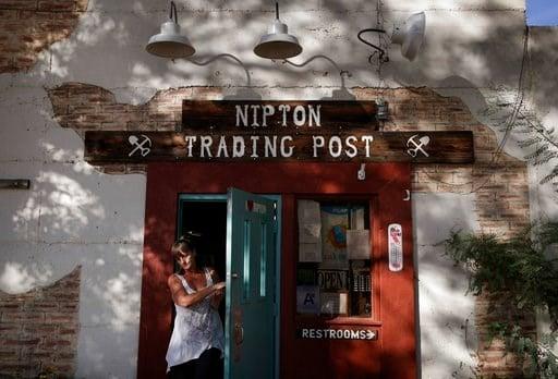 (AP Photo/John Locher). A woman leaves the Nipton Trading Post, Thursday, Aug. 3, 2017, in Nipton, Calif.
