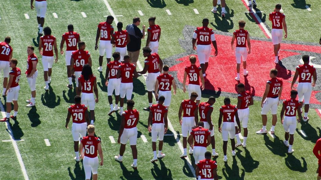 Louisville football players disperse after their team picture before Media Day on Saturday. (WDRB photo by Eric Crawford).