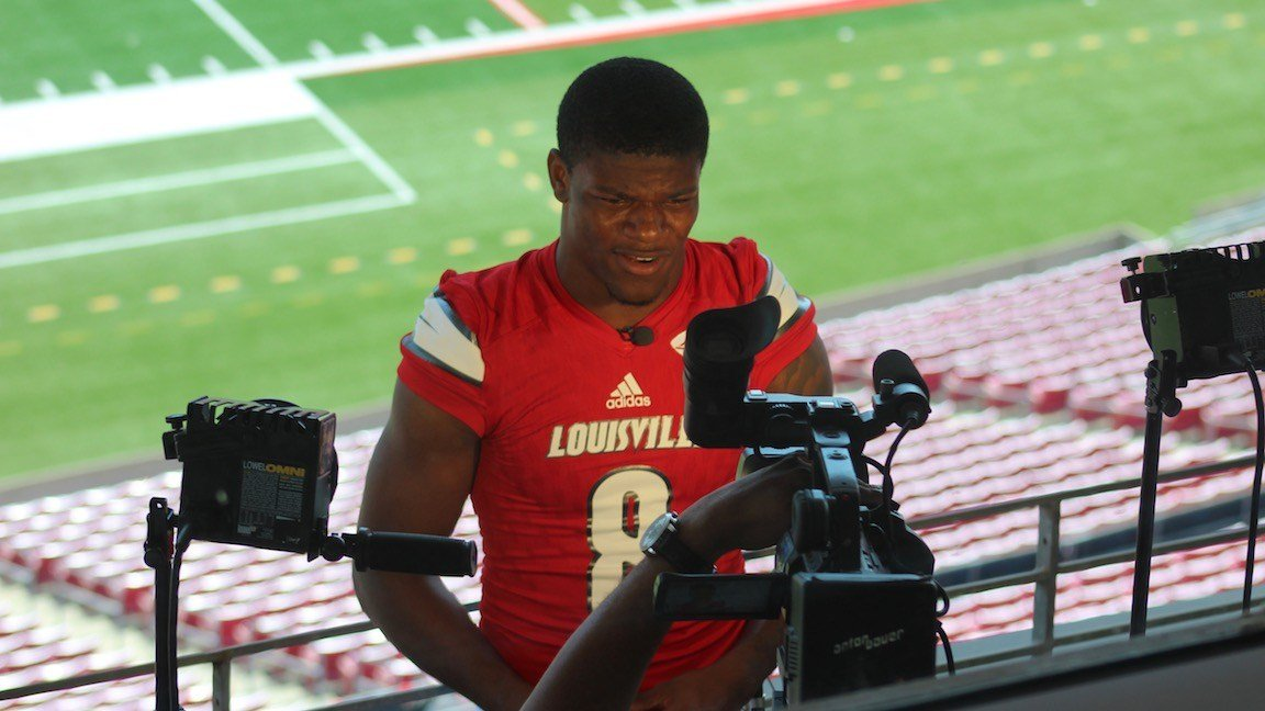 Lamar Jackson conducts an interview at Louisville's Media Day. (WDRB photo by Eric Crawford)