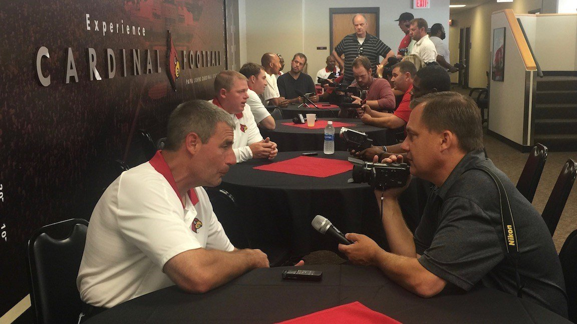 Louisville's assistant football coaches speak with reporters at 2017 Media Day. (WDRB photo by Eric Crawford).