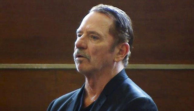 (WCVB-TV via AP, Pool). In this still image from video, actor Tom Wopat stands during arraignment Thursday, Aug. 3, 2017, in Waltham, Mass., on indecent assault and battery and drug possession charges.