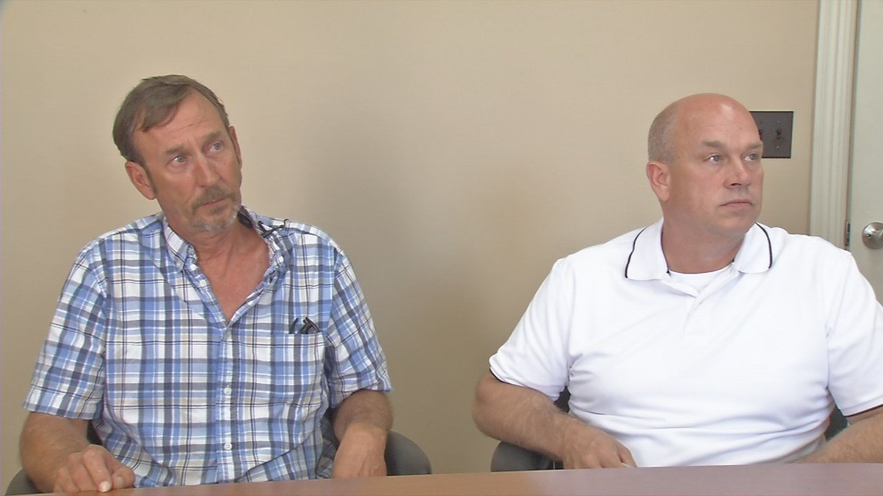 Roger (left) and Mike (right) Ballard announce $20,000 reward for information on their brother Tommy Ballard's death.