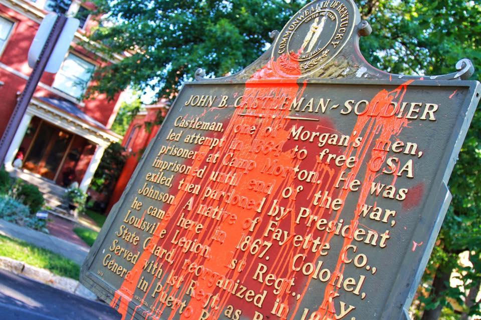 John B. Castleman monument plague covered in orange paint.