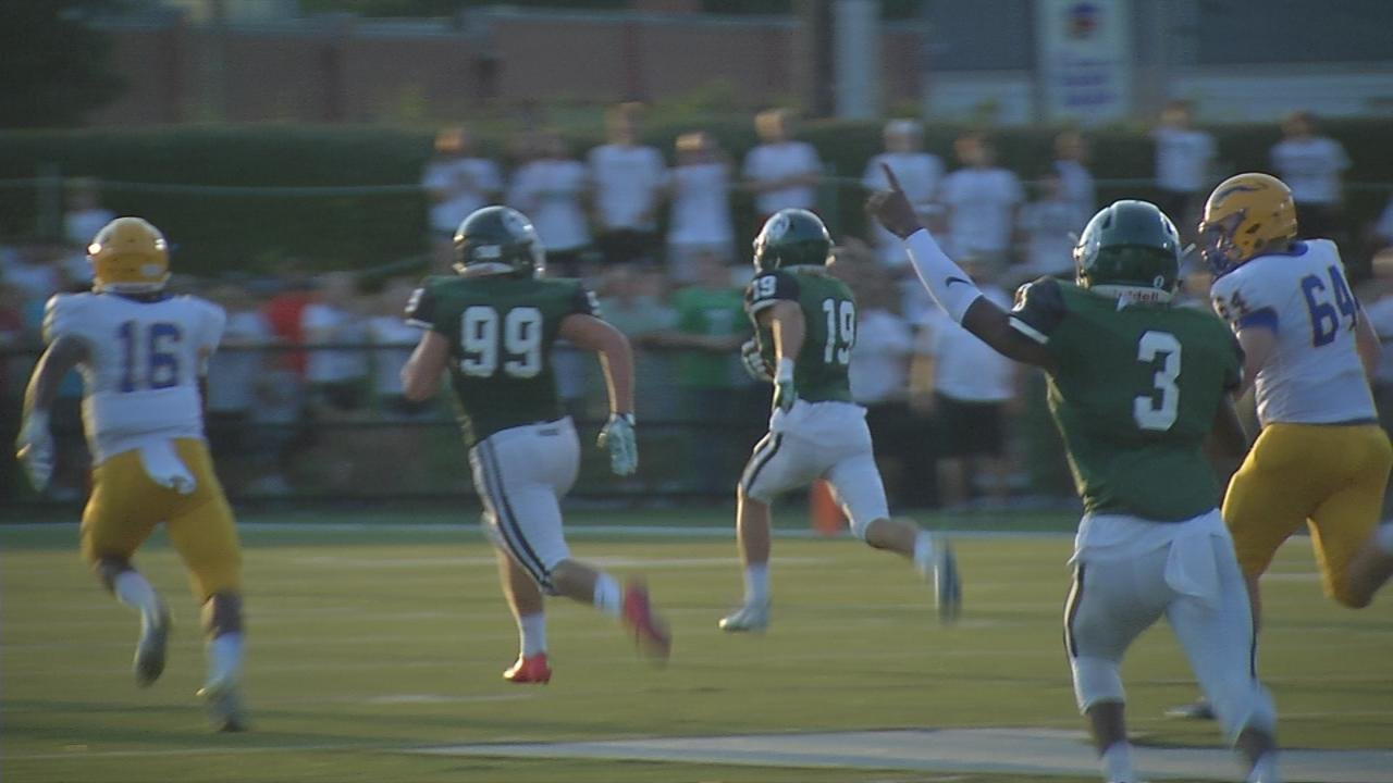 Trinity's Jacob Dingle kept the Shamrocks' momentum with his interception and 85-yard return for a touchdown to give the Rocks a 14-0 lead overCarmel.