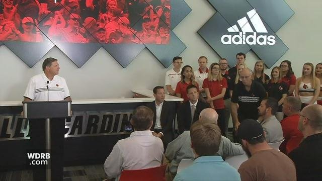 Tom Jurich, left, announced the Adidas extension in August.