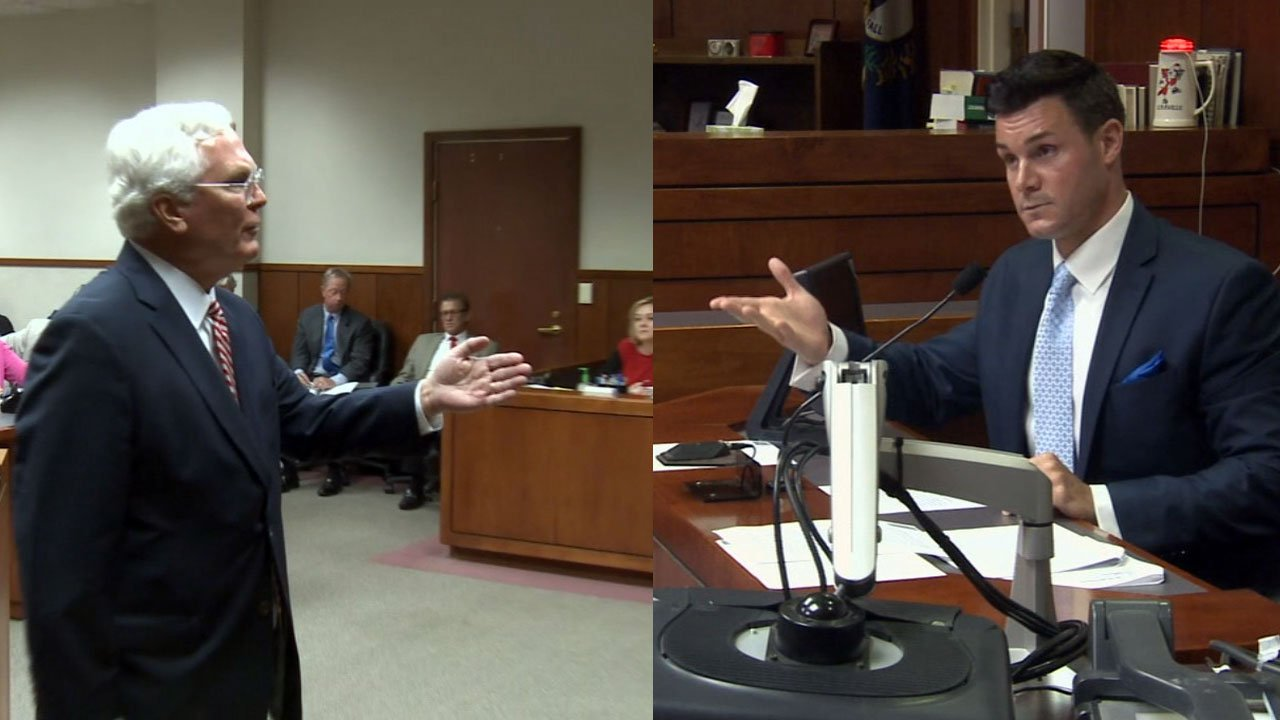 Jefferson County Attorney Mike O'Connell and Louisville Metro Council President David Yates spar verbally in court.