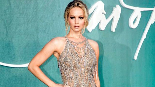 (Photo by Vianney Le Caer/Invision/AP, File). FILE - This Sept. 6, 2017 file photo, Jennifer Lawrence poses for photographers upon arrival at the premiere of the film Mother'', in London.