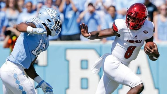 Lamar Jackson eludes a North Carolina defender (AP photo)