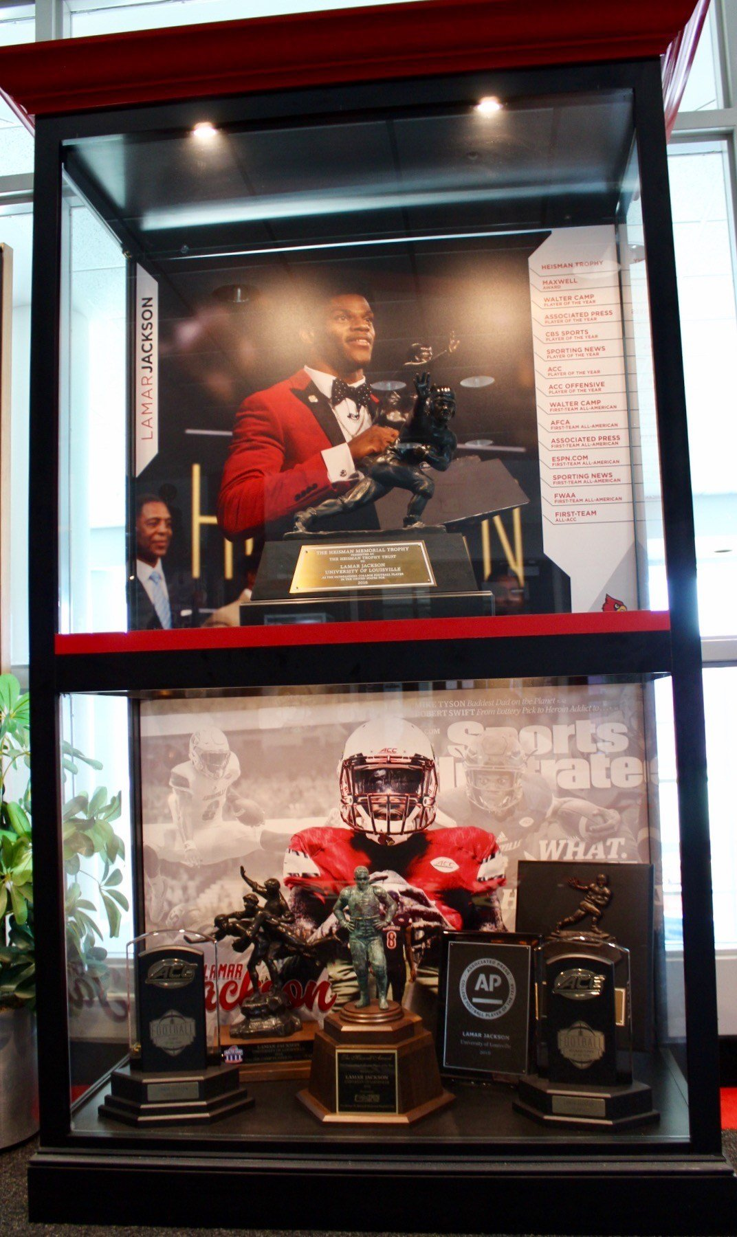 The new trophy case at U of L featuring Lamar Jackson's Heisman and various national player of the year awards (WDRB photo by Eric Crawford)
