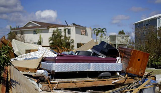 (AP Photo/David Goldman). A bed sits amongst the remains of its room in a home demolished from Hurricane Irma in Goodland, Fla., Tuesday, Sept. 12, 2017.