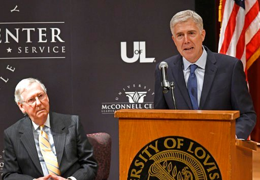 U.S. Supreme Court Justice Neil Gorsuch, right, and Senate Majority Leader Mitch McConnell, appeared at an event at the University of Louisville on Thursday. (AP photo)