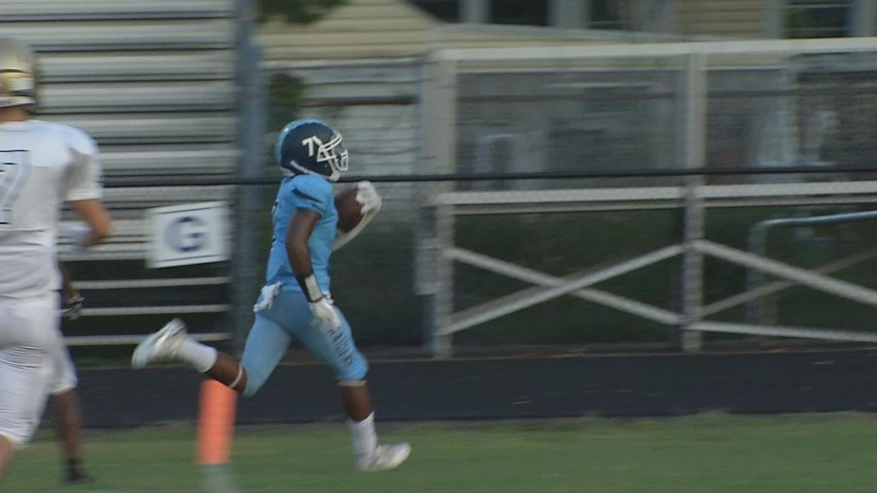 Iroquois' Cory Foster kept it himself and hit the sideline en route to an eight-yard touchdown run.