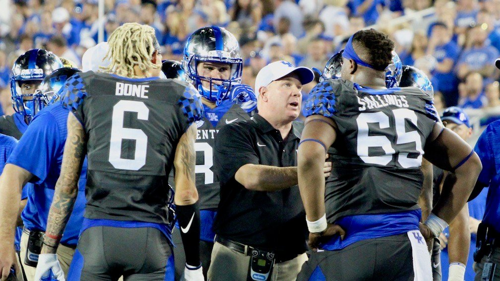 Kentucky coach Mark Stoops talks to his timeout during a timeout. (WDRB photo by Eric Crawford)