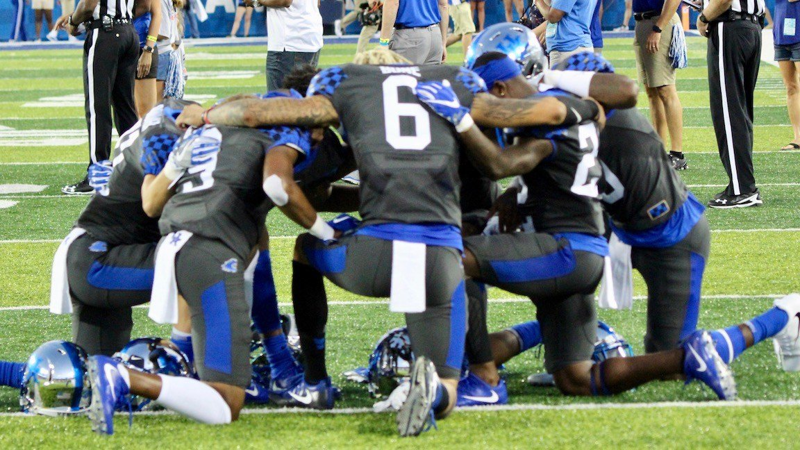 Kentucky wideouts pray before their game with Florida. (WDRB photo by Eric Crawford)