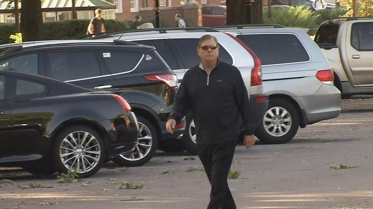 Tom Jurich enters Grawemeyer Hall on Wednesday following a meeting with U of L interim President Greg Postel and board of trustees chairman David Grissom