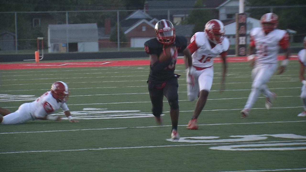 New Albany's Darquan Richardson hits the hole and goes62 yards for a touchdown.