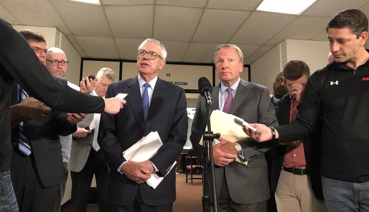 University of Louisville board of trustees chairman J. David Grissom, left, and interim president Greg Postel address the media on Monday, Oct. 2, 2017.