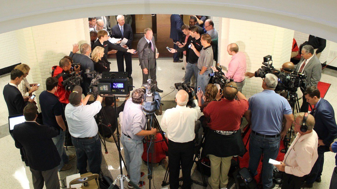 Louisville interim president Greg Postel speaks to media after Monday's board of trustees meeting. (WDRB photo by Eric Crawford)