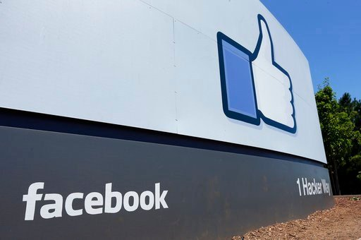 (AP Photo/Ben Margot, File). FILE - This July 16, 2013, file photo shows a sign at Facebook headquarters in Menlo Park, Calif.
