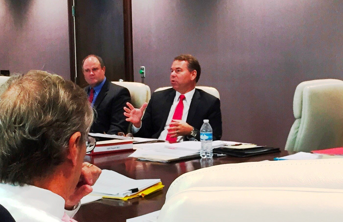 Vince Tyra, center, at a meeting of the U of L Foundation board of directors on Sept. 28, 2017
