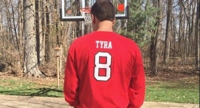 On his Twitter account, acting Louisville athletic director Vince Tyra honors his father, Charlie, a former U of L basketball star whose Number 8 was retired.