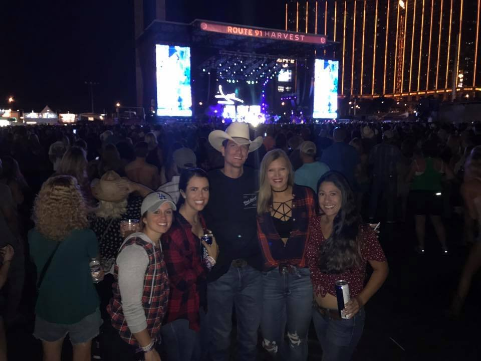 Wolny and Roberts pose with friends at the music festival in Las Vegas before the shooting.