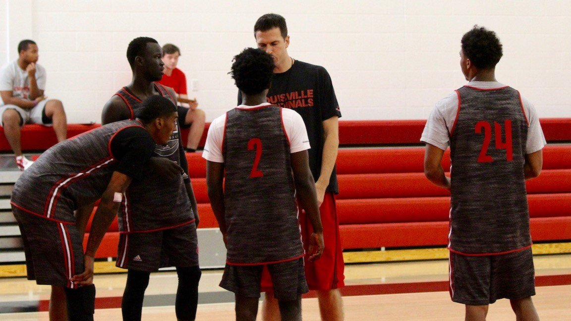 David Padgett works with a group of players in a University of Louisville practice on Wednesday. (WDRB photo by Eric Crawford)