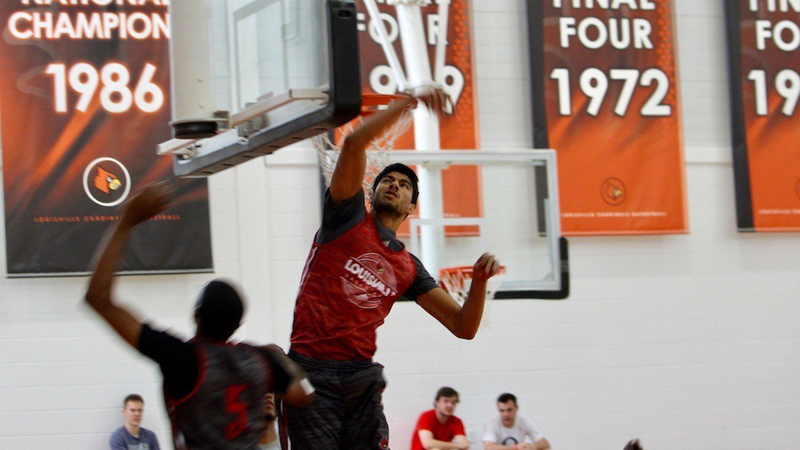 Anas Mahmoud blocks a shot in a University of Louisville basketball practice. (WDRB photo by Eric Crawford)