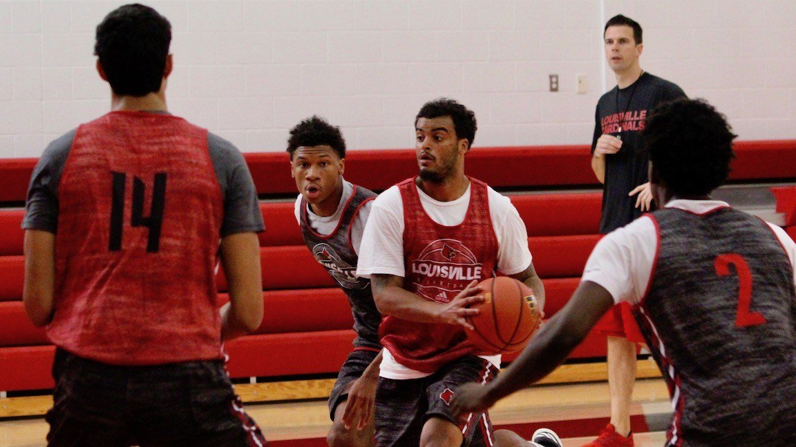 Quentin Snider drives into traffic while David Padgett watches during University of Louisville basketball practice on Wednesday (WDRB photo by Eric Crawford)