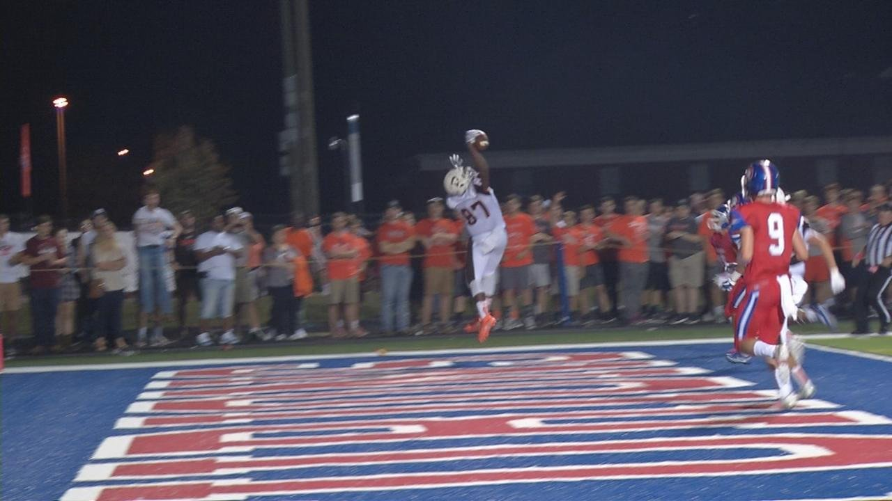 DeSales quarterback Aaron Pfaadt rolls out and hits Demetri Scott, who makes a one-handed catch in the end zone for the touchdown.