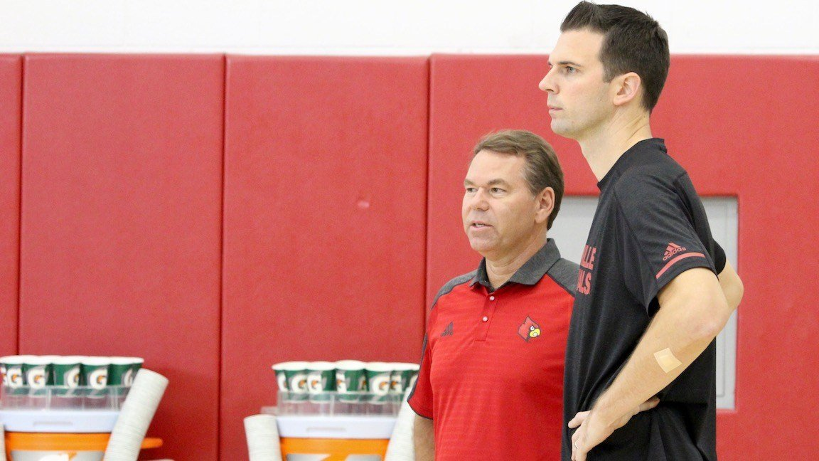 David Padgett and acting Louisville AD Vince Tyra watch players work out in a recent practice. (WDRB photo by Eric Crawford)