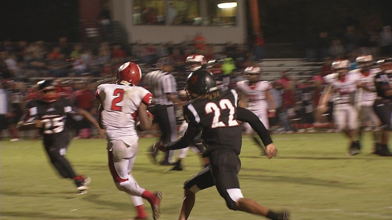 DuPont Manual's Zach Recktenwald throws a bullet across the middle to Bryant Robinson to set up a touchdown.